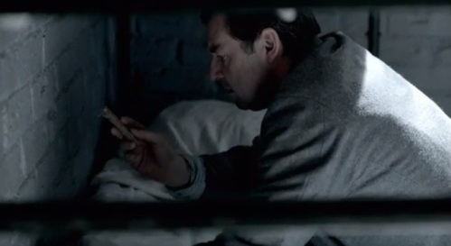 Bates finding the contraband his cell mate planted.